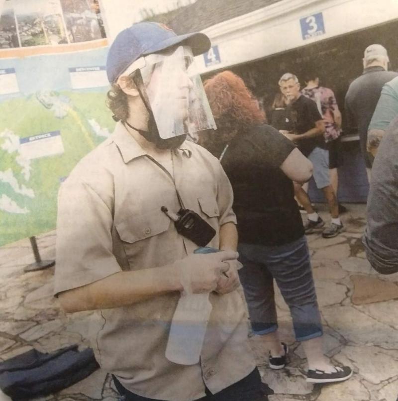 Gatlinburg worker with sneeze guard + chin mask